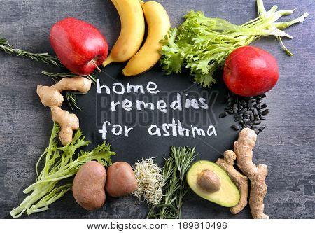 Fresh vegetables and fruits around text HOME REMEDIES FOR ASTHMA on grunge background