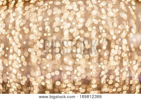 Festive abstract background with bokeh lights. Gold and blue bokeh background of new year Lights.
