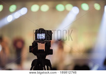 Camcorder at Fashion show Wedding fair out of focusblur background.