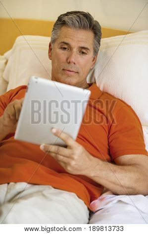 Caucasian man using tablet computer