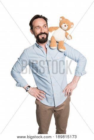 Smiling Bearded Man With Teddy Bear On Shoulder Posing Isolated On White