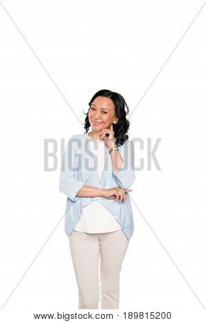 Smiling Asian Woman Standing In Thoughtful Pose Isolated On White