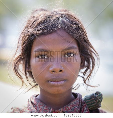 HIMALAYAS ANNAPURNA REGION NEPAL - OCTOBER 23 2016 : Portrait nepalese child on the street in Himalayan village Nepal