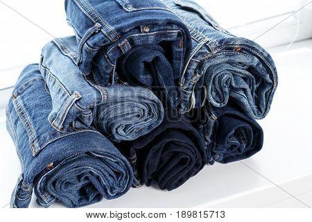 torn jeans stack background blue denim fashion beauty