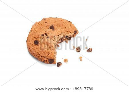 Single round chocolate chip biscuit with crumbs and bite missing isolated on white from above. Sweet biscuits. Homemade pastry. Chocolate chip cookie.