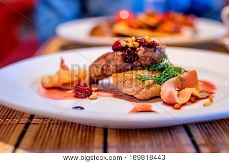 Grilled beef medallions with cherry sauce and balsamic vinegar