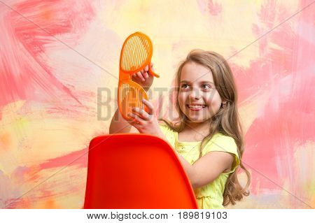 Happy Baby Sitting On Orange Chair In Summer Glasses