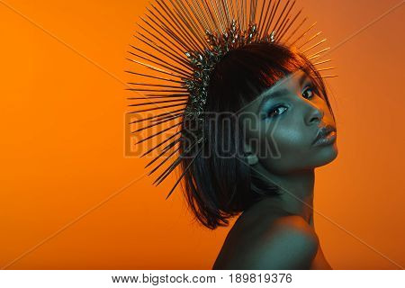 Stylish African American Girl In Headpiece With Needles Looking At Camera
