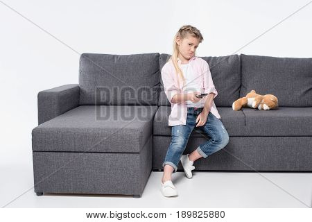 Grimace Little Girl Changing Tv Channels With Remote Control Isolated On White