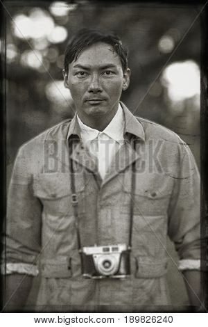 Asian man wearing camera outdoors