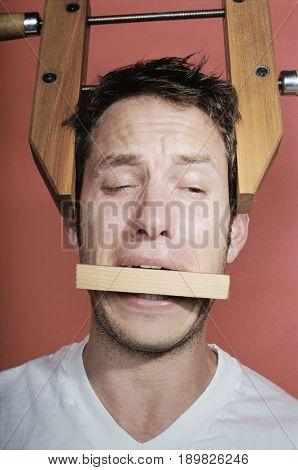 Man wearing vice on head