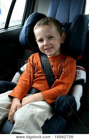 little boy in car safety seat