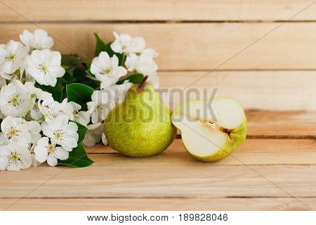 The Ripe Pear And The Blossom On The Wooden Table