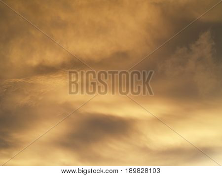 twilight zone abstract background, gold sky and cloudy in last light of the day