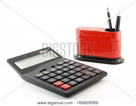 calculator and desk organizer with pen and clutch-type pencil isolated on white background