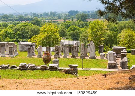 Philippi, Greece - April 30, 2016: Ancient ruins remains, stones, pottery in province of Lydia, Philippi, Greece