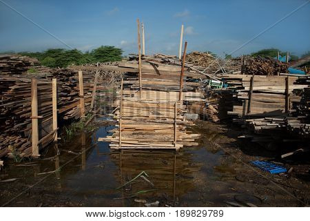 Stack of teak wood boards in lumber yard. pile Wooden