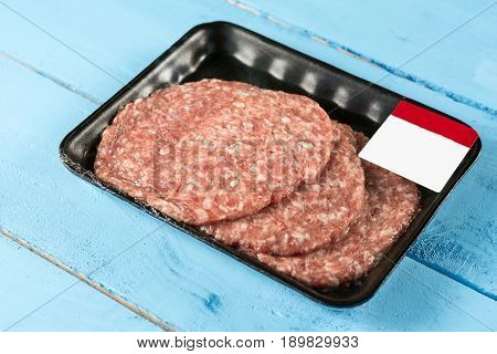 Raw Minced Meat Burgers In The Market Package With Price Tag