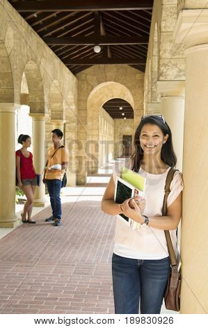 Middle Eastern student smiling on campus
