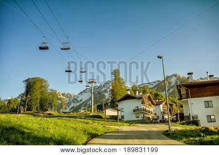 A Canopy Chairlift And Chalet In Mountains. Rosa Khutor In The Summer, Adler