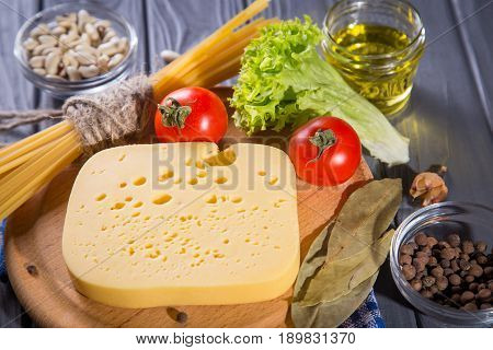 assortment of food-macaroni,cheese,oil and vegetables in studio