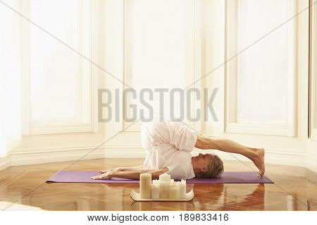 Older Caucasian woman practicing yoga