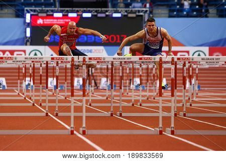 BELGRADE SERBIA - MARCH 3-5 2017: MAN 60M HURDLES SVOBODA PETR POZZI ANDY EUROPEAN ATHLETICS INDOOR CHAMPIONSHIPS IN BELGRADE SERBIA