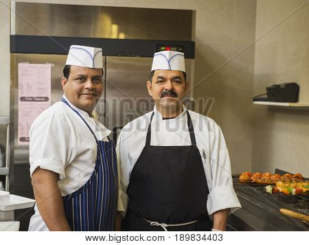 Chefs smiling in kitchen