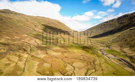 Wrynose Pass, English Lake District, Cumbria. Aerial drone image of the landscape of the English Lake District along the Wrynose Pass looking towards Harter Fell.