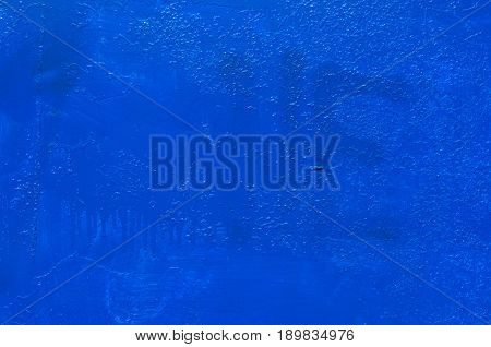 Blue rusty metal texture. Wall of sheet metal painted in blue