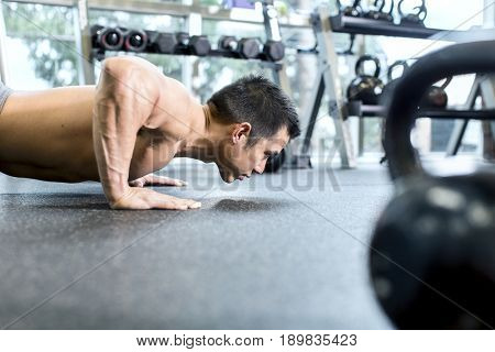 Pacific Islander man working out in gym