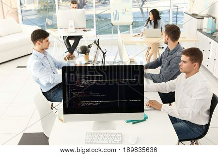 Web site codes on computer monitor in office