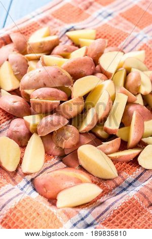 Sliced Young Potatoes Drying On The Kitchen Dishcloth