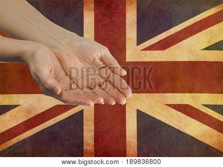 Give your Country your Support  - Female hands in open gesture against a rustic parchment Union Jack Flag with copy space