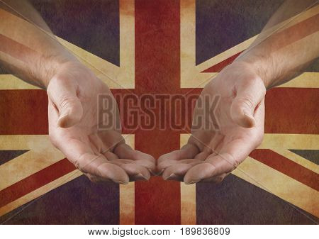 Support Great Britain - Male hands in open gesture against a rustic parchment Union Jack Flag with copy space