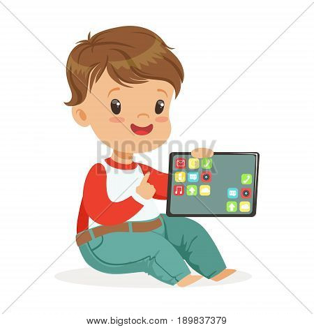 Smiling little boy sitting on the floor and playing with digital tablet. Child and modern technology colorful cartoon character vector Illustration isolated on a white background