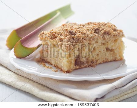 Piece of coffeecake isolated on white. Biscuit with strawberry, rhubarb and apples. Homemade crumble pie with streusel topping. Isolated. Selective focus.