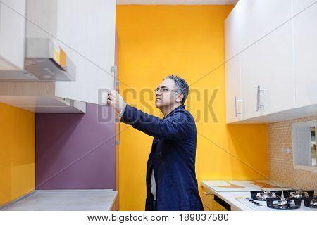 Man choosing kitchen in a furniture shop center