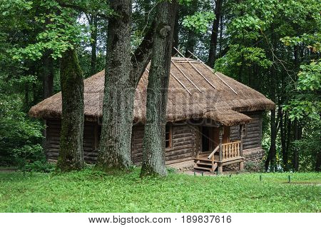 Wooden bath among the thick oaks in the manor of the village of Trigorskoye State Museum-reserve of A. S. Pushkin in Pushkinskiye Gory Russia