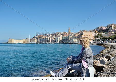 Woman relaxes on the seafront of Gaeta Lazio Italy
