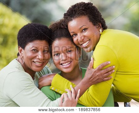 Three generations of Black women smiling