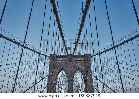 famous brooklyn bridge tower with american flag on top, new york city