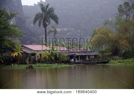 Floating fishing house among karst mountains on Tam Coc river, Ninh Binh, Vietnam