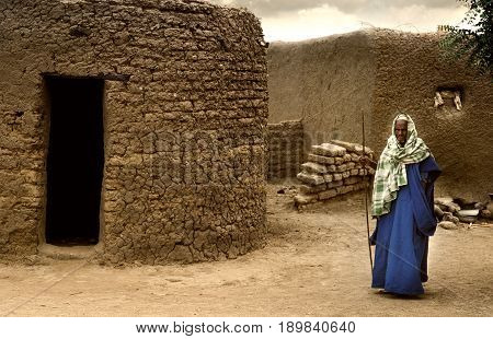 Mali, West Africa - January 25, 1992: Peul Village And Typical Mud Buildings