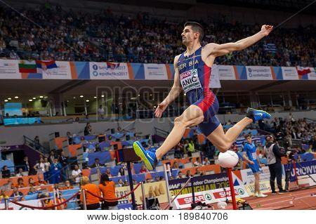 BELGRADE SERBIA - MARCH 3-5 2017: LONG JUMP MAN LAZAR ANIC EUROPEAN ATHLETICS INDOOR CHAMPIONSHIPS IN BELGRADE SERBIA
