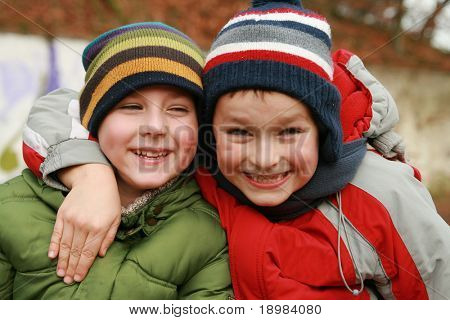 Portrait of two boys, siblings, brothers and best friends.