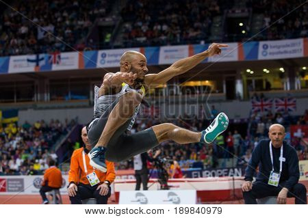 BELGRADE SERBIA - MARCH 3-5 2017: MAN LONG JUMP HOWARD JULIAN EUROPEAN ATHLETICS INDOOR CHAMPIONSHIPS IN BELGRADE SERBIA