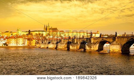 Prague Hradcany Panorama on golden sunny day. Charles Bridge over Vltava River with Prague Castle, Czech Republic.