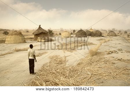 Mali, West Africa - Peul Village And Typical Mud Buildings