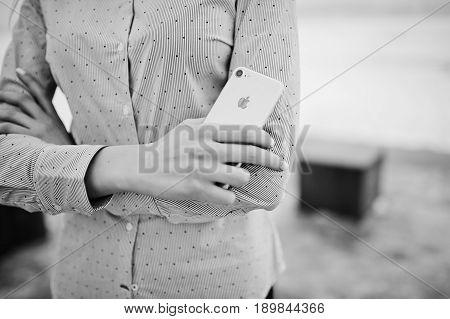 Ozerna, Ukraine - February 8, 2017: Close Up Apple Iphone 7 On Hands At Stylish Girl. Black And Whit